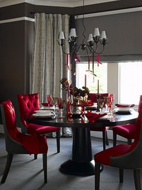 elegant dining room with chocolate brown walls and red chairs