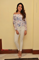 Actress Pragya Jaiswal Latest Pos in White Denim Jeans at Nakshatram Movie Teaser Launch  0049.JPG