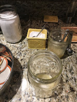 Photo of jars of citric acid, salt, and lemon juice with lemon juice and salt in a canning jar prepared for canning tomatoes. https://trimazing.com/