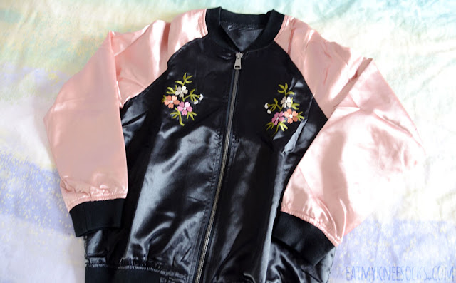 Details on the dusty pink and black floral embroidered oversized satin bomber jacket from SheIn.