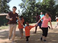 internationals-running-with-Ethiopian-kids