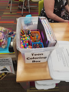 box filled with coloring instruments on a table