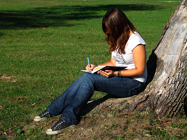 NAMC montessori focusing on desired behavior friendship theme classroom girl writing journal
