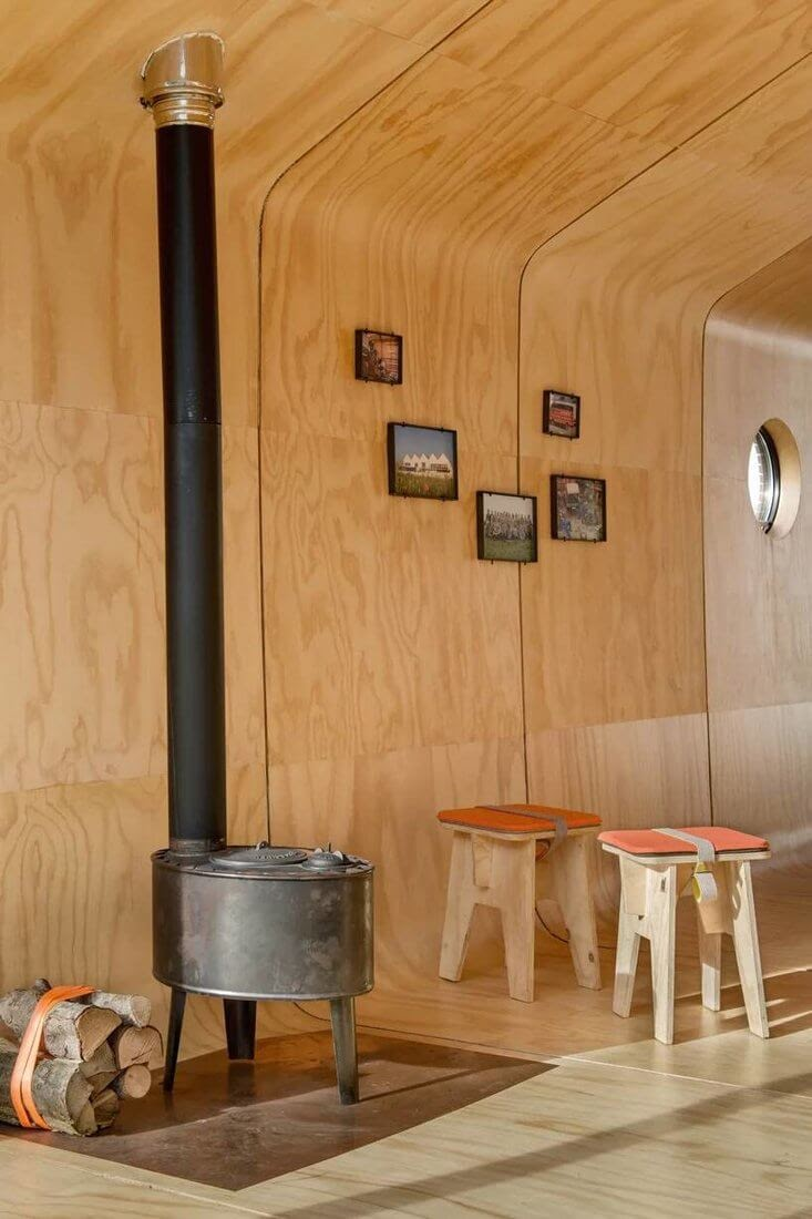 03-Wood-Stove-Fiction-Factory-Wikkel-House-Cardboard-Architecture-www-designstack-co