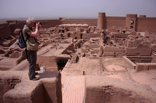A traveler taking photo in Rayen Castle. Kerman- Iran