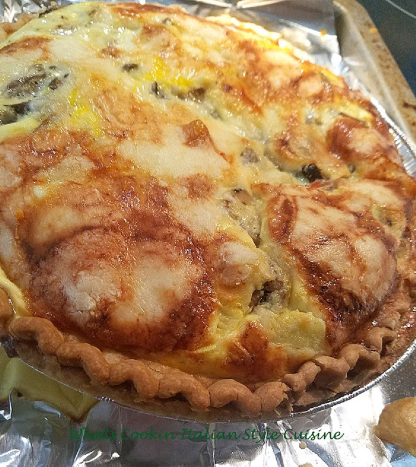 This is a mushroom zucchini egg filled pie in a delicate crust baked until golden brown