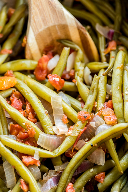 Slow Cooker Southern Green Beans - so simple and they taste AMAZING!! Just dump everything in the slow cooker and let it work its magic! Fresh green beans, red onion, lemon, tomatoes, garlic, chicken broth, salt and pepper. We make a batch on Sunday and eat the green beans all week with lunch and dinner. Great for cookouts, potlucks, tailgating and the holidays!