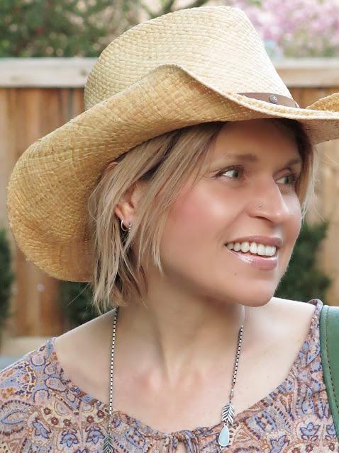 cowboy hat, paisley blouse