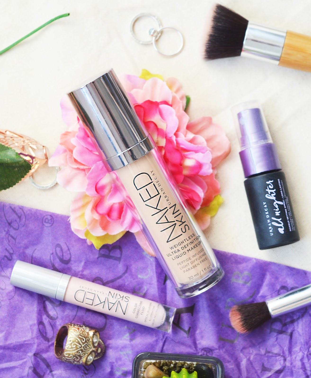 urban decay naked skin flatlay with flowers