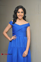 Actress Ritu Varma Pos in Blue Short Dress at Keshava Telugu Movie Audio Launch .COM 0020.jpg