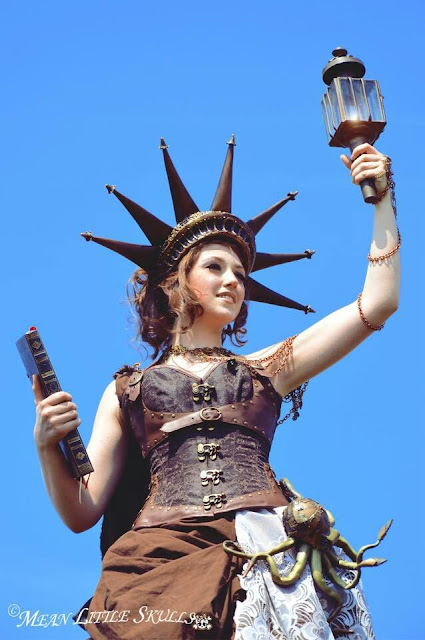 steampunk statue of liberty costume for women. crown, torch, book, skirt and corset. USA, americana or american icons steampunk'd
