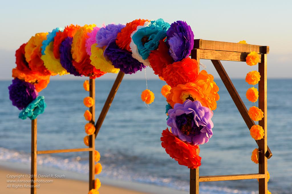 a photo of a wedding trellis on a beach in mexico