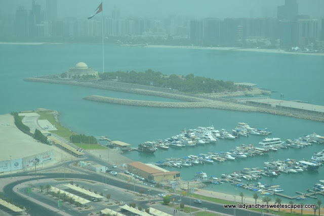 view of Abu Dhabi's yacht club and skyline from Marina Mall Sky Tower