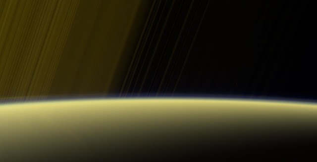 This false-color view from NASA's Cassini spacecraft gazes toward the rings beyond Saturn's sunlit horizon, where a thin haze can be seen along the limb. Credits: NASA/JPL-Caltech/Space Science Institute