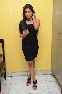 Vrushali Gosavi in strapless Short Black Dress At Follow Follow U Audio Launch 051.JPG