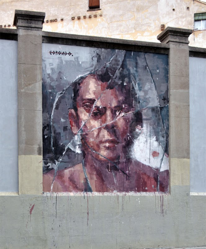Last seen in London with Triade (covered), Borondo is now back at home where he just finished working on this new piece somewhere on the streets of Madrid, Spain.