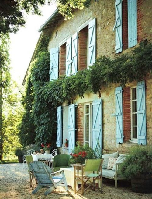 Kathryn Ireland's glorious #Frenchfarmhouse with blue shutters and gravel courtyard