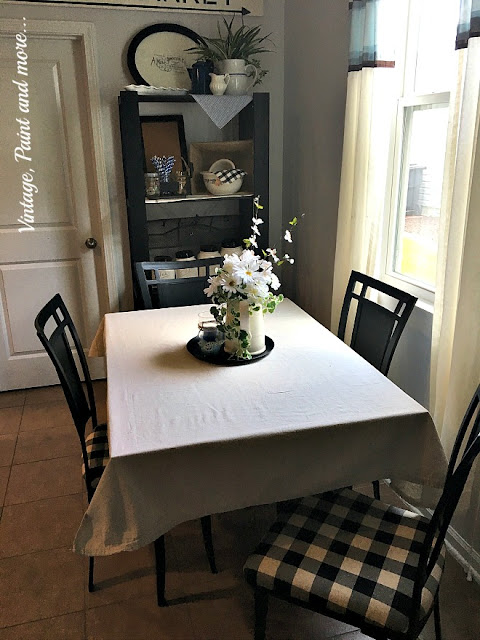 Vintage Paint and more... Thrift store table and chairs upcycle with black chalk paint and black and cream buffalo plaid for an eat in vintage industrial kitchen