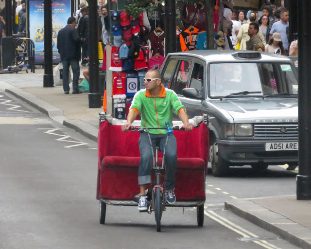 Pedicab with a couch, Oxford Street, London