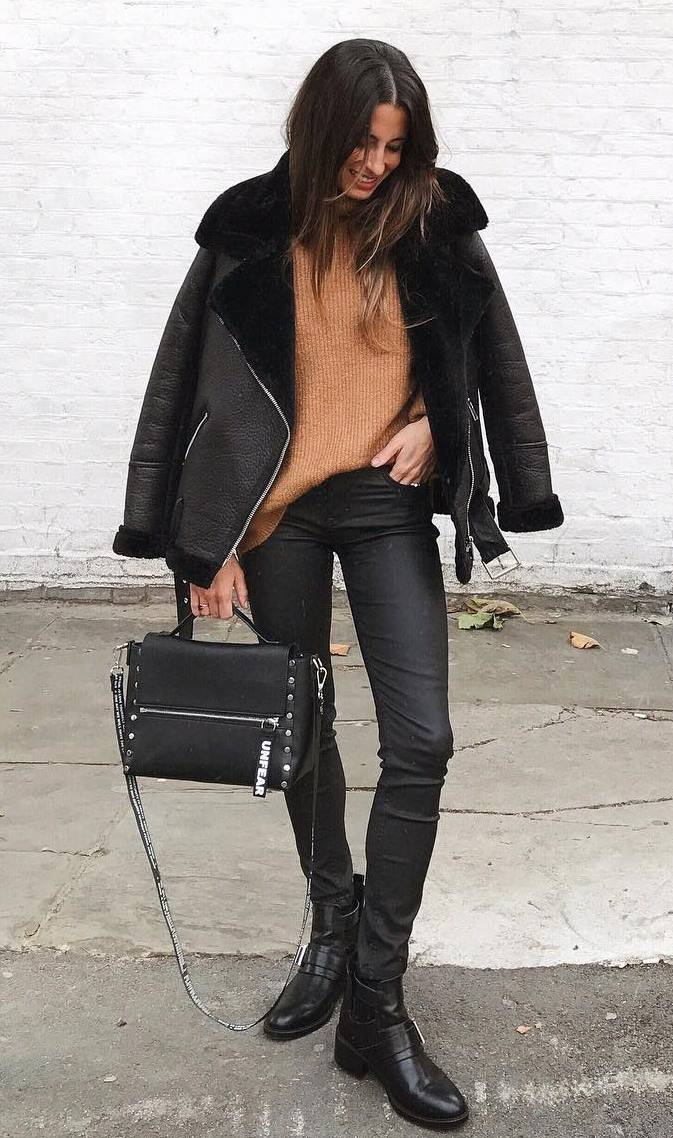 what to wear with a leather jacket : brown sweater + bag + black pants + boots