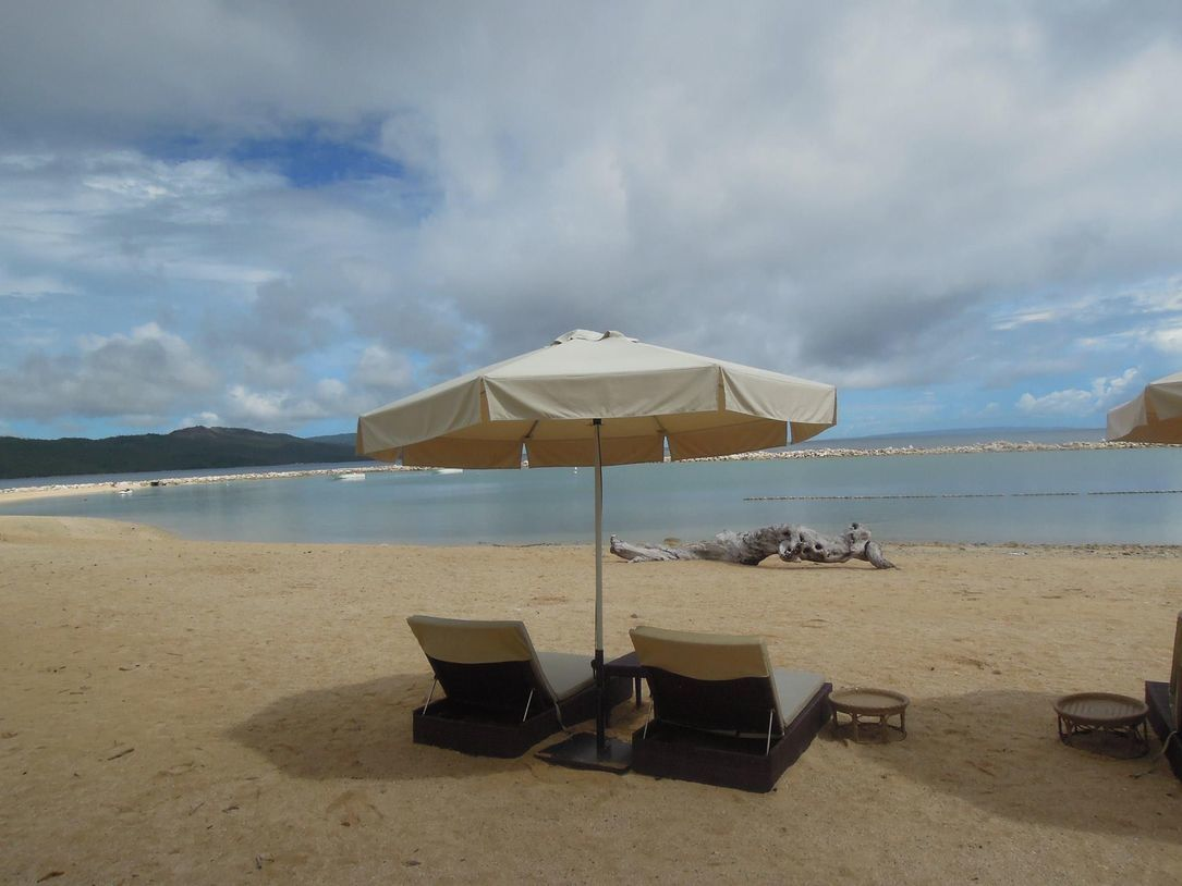 Beach umbrella and benches in Misibis Bay