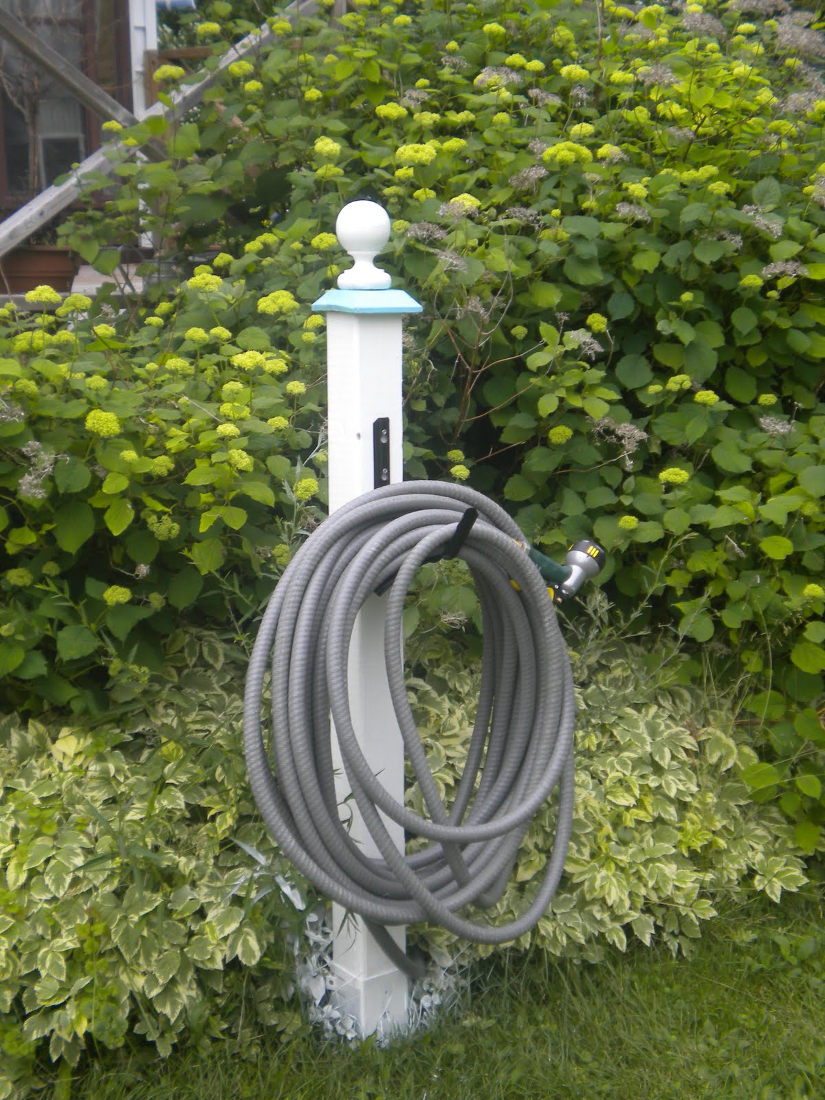 THISTLE HOUSE: outdoor number sign and hose holder