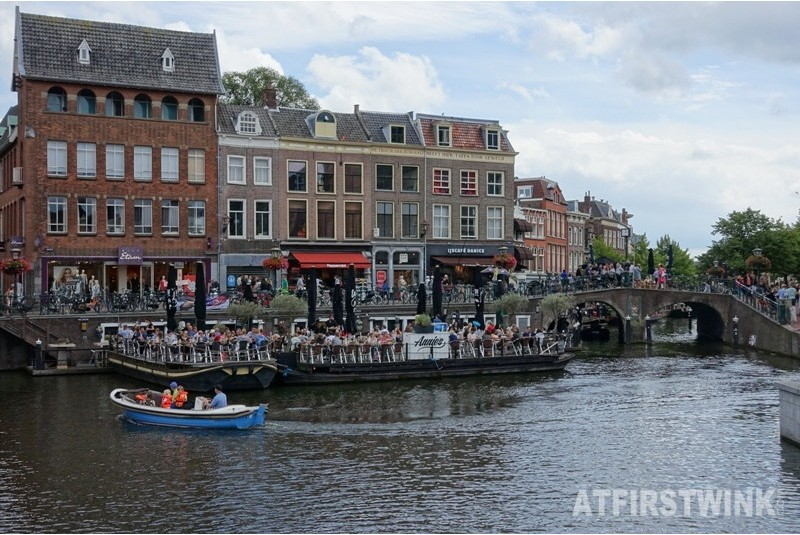 terrace boats Leiden Netherlands bridge traditional houses