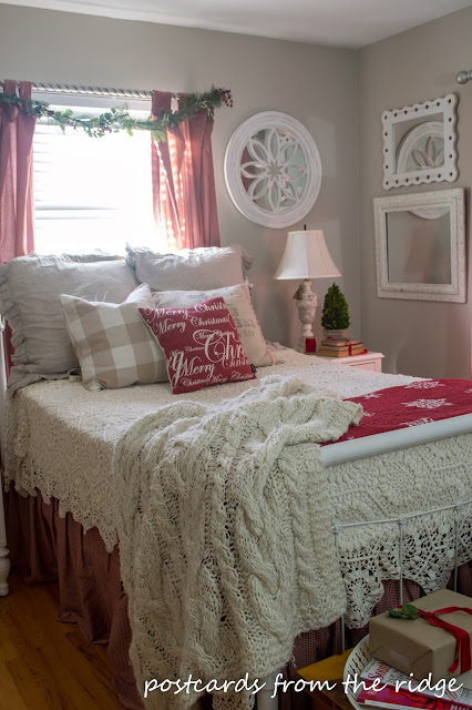 Lovely guest bedroom with red accents.
