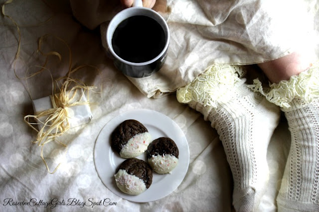 Chocolate Peppermint Cookies Recipe, Peppermint Cookies, by Rosevine Cottage Girls | photo of a womans feet in lacy socks, a cup of coffee and a gift in white wrapping paper. A plate of peppermint cookies on a blanket