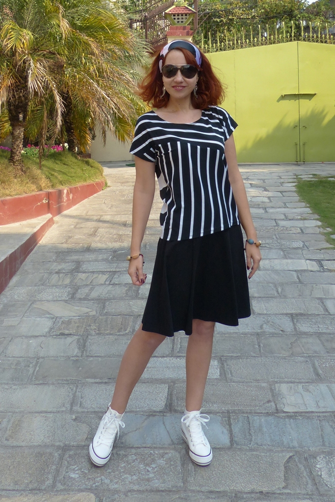 Sporty style look: white converse shoes, stripy black and white top, headscarf, sunglasses