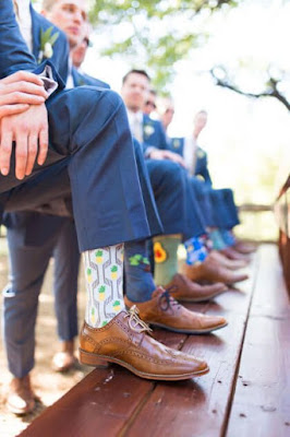 K'Mich Weddings - wedding planning - grooms sitting showing off their socks