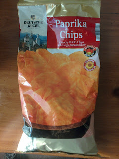 An opened bag of Deutsche Kuche Paprika Chips, from Aldi