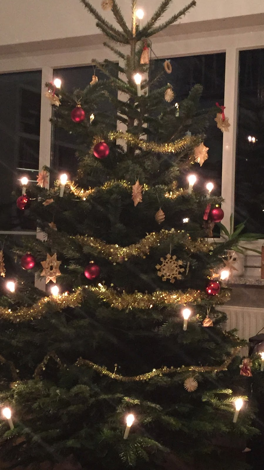 Image showing a German Christmas tree with gold and red decorations