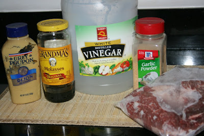 molasses, vinegar, garlic powder, dijon mustard are the ingredients needed to make sweet mustard roast in the crockpot slow cooker with beef or pork