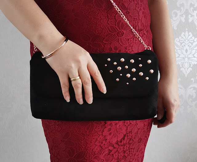 Burgundy dress with black and rose gold accessories