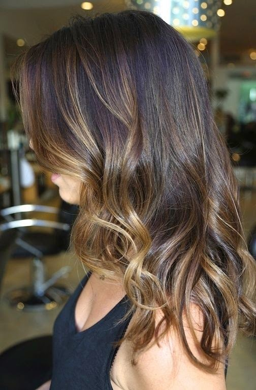 Subtle caramel highlights on brown hair