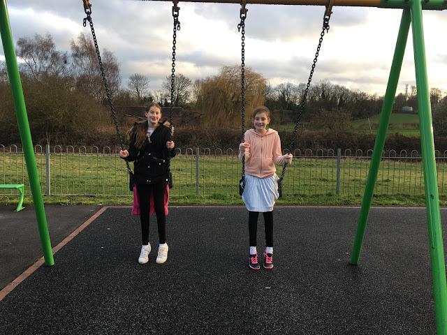 stephs two girls on swings
