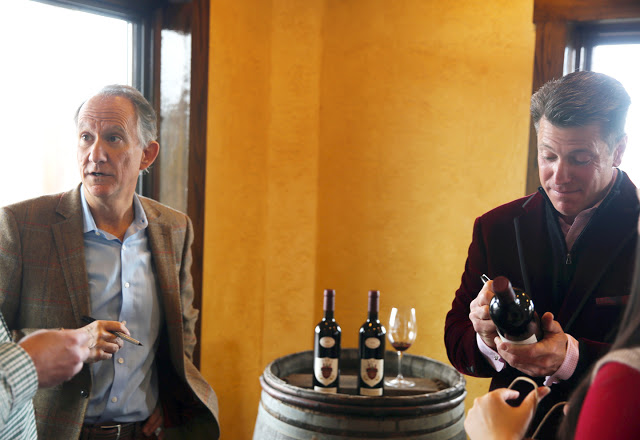 Jay Raffaldini, left, of Raffaldini Vineyards, and JW Ray, of JOLO Winery sign bottles of the collaboration wine.