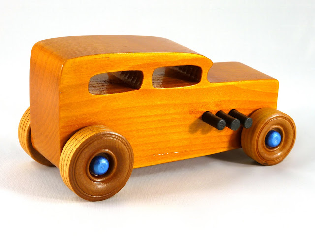 Right Rear - Wooden Toy Car - Hot Rod Freaky Ford - 32 Sedan - Pine - Amber Shellac - Black Pipes - Metallic Blue Hubs