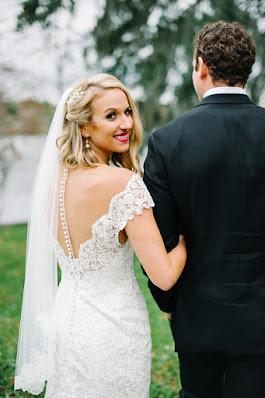 bride with buttons on gown looking back