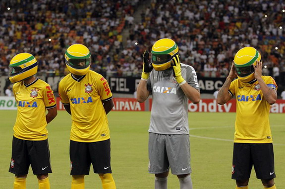 Corinthians players wear replicas of the helmet worn by late Formula One driver Ayrton Senna