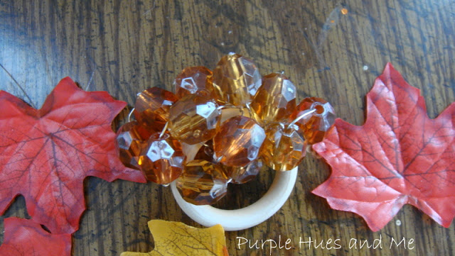DIY Dollar Store Beaded Napkin Ring from Purple Hues and Me - via Setting for Four