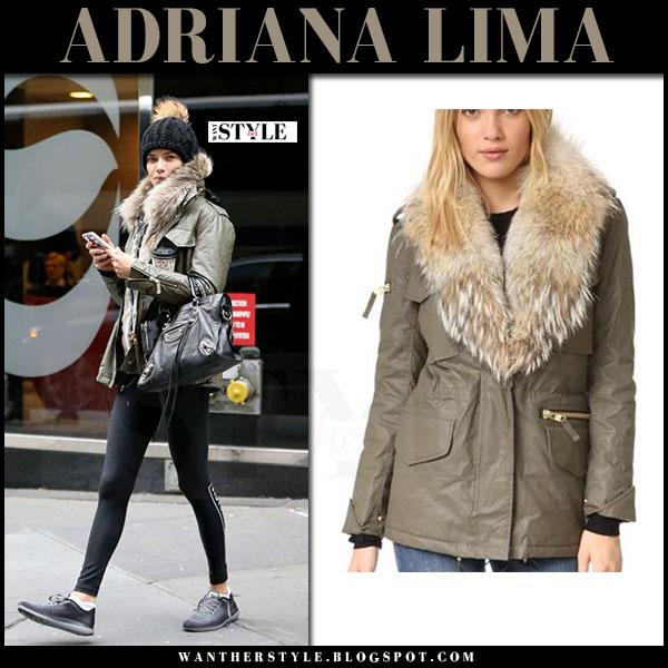 Adriana Lima in khaki green SAM jacket and black leggings what she wore off duty style