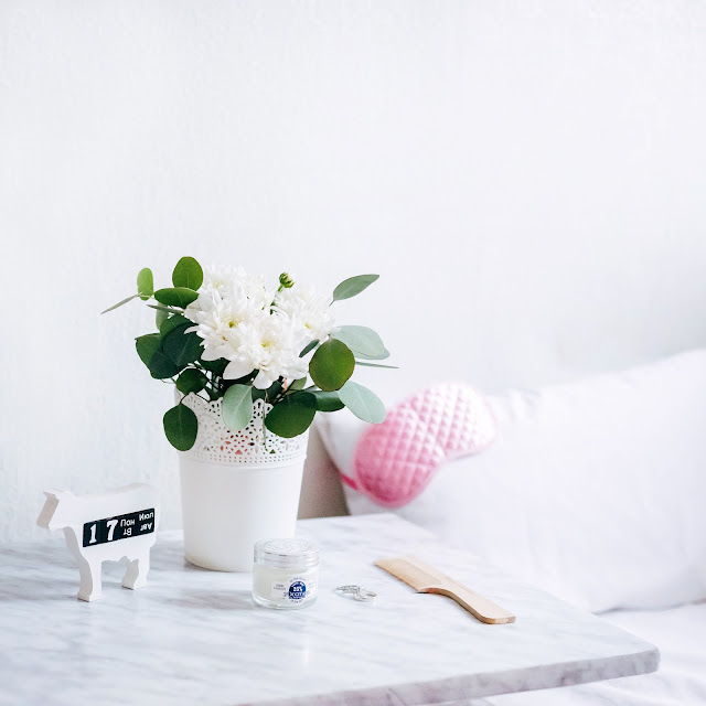 marble bedside table with flowers