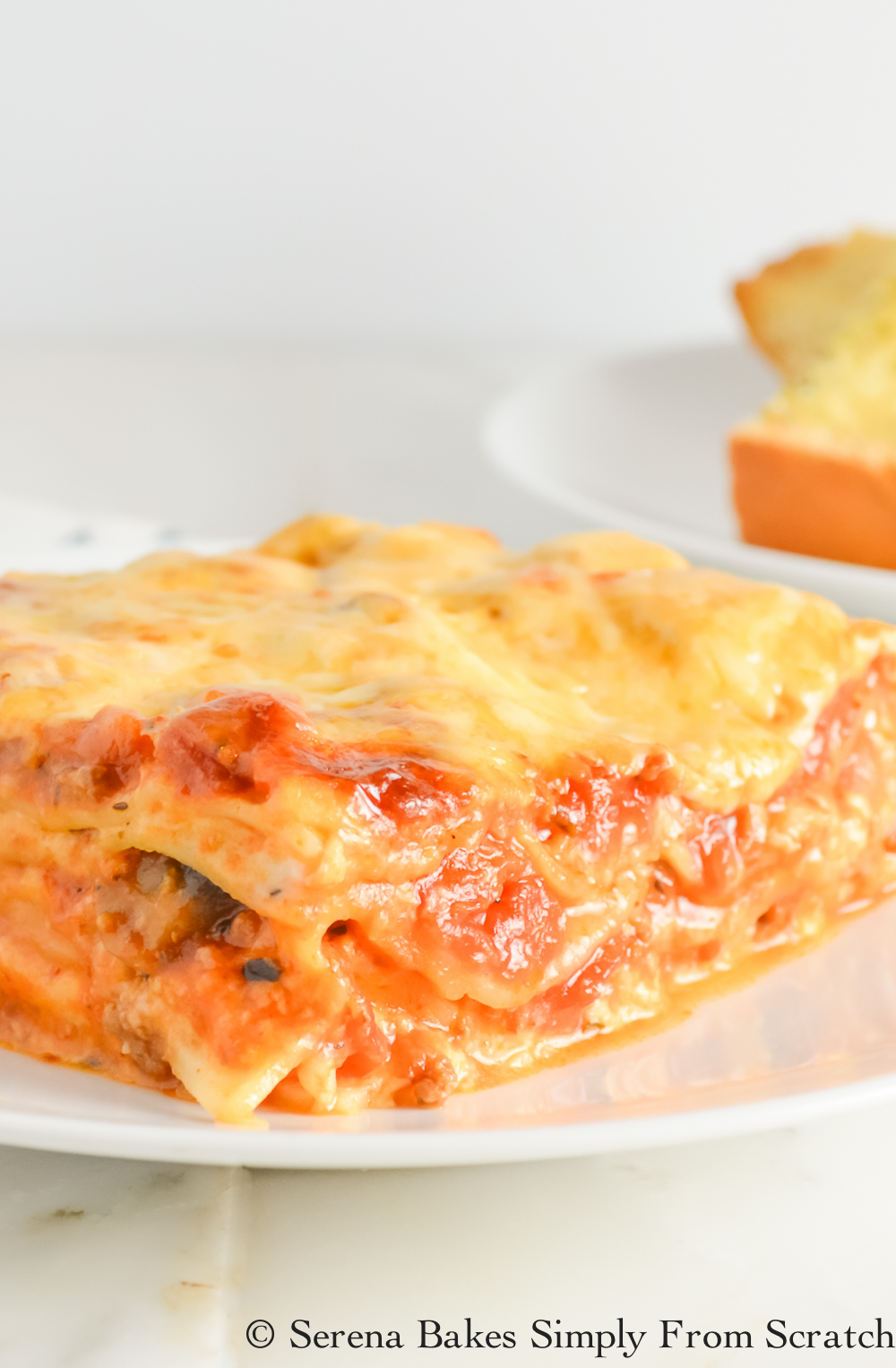 Lasagna with creamy béchamel sauce is a great alternative to ricotta! It will quickly replace your traditional lasagna recipe. serenabakessimplyfromscratch.com