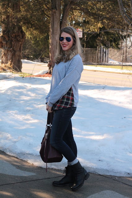 grey and plaid sweatshirt, silver jeans joga jeans, combat boots, burgundy bag, ray bans