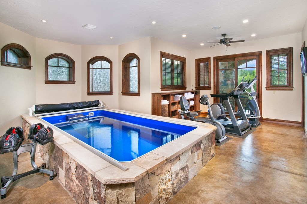Endless Pool in a home gym; installation by Factory-Trained Installer Pete Wackman.