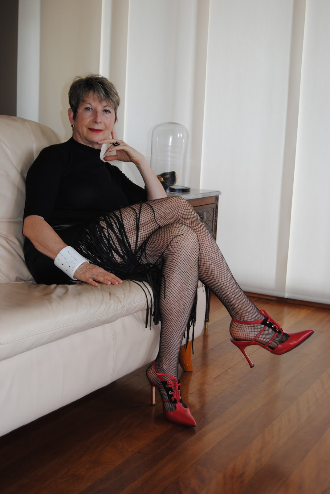looking fabulous @ fifty: leather skirt, fishnet stockings|rock
