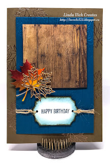 Linda Vich Creates: Colorful Seasons Birthday. Heat embossed copper leaves peak from beneath a dry embossed wood plank matte, topped with a square of Wood Textures DSP that is embellished with die cut leaves.