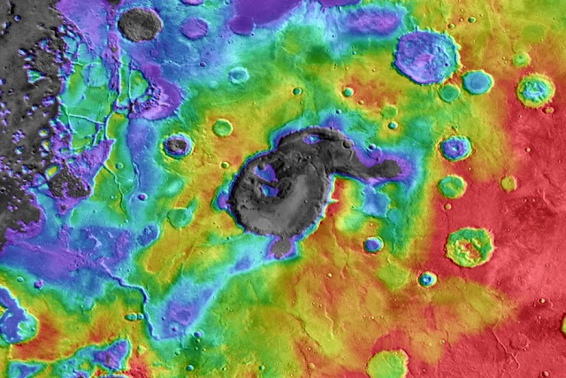 Eden patera, a depression about 85 kilometres long, 55 kilometres wide and 1.8 kilometres deep, is the best example of suspected supervolcanoes on Mars. Its caldera is shown here as a gray bullseye. Credit: NASA/JPL/GSFC/ARIZONA STATE UNIVERSITY
